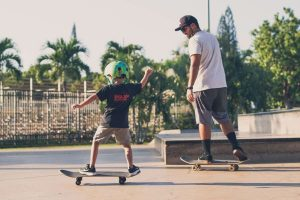 Father and son skateboarding - Wealth Connexion