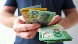 Money bills on hand - Wealth Connexion