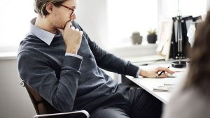 A man thinking at his desk - Wealth Connexion